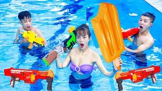NTK Nerf Movies: Squad Seal Warriors Go Swimming Nerf Guns ICE CREAM BATTLE Fight Criminal at Pool