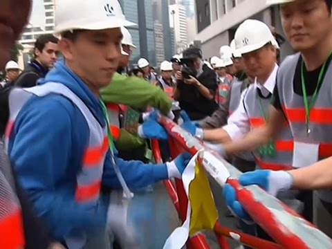 Raw: Hong Kong Protester Barricades Removed