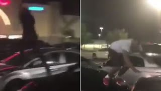 Acrobats Vandalize Cars in Movie Theater Parking Lot