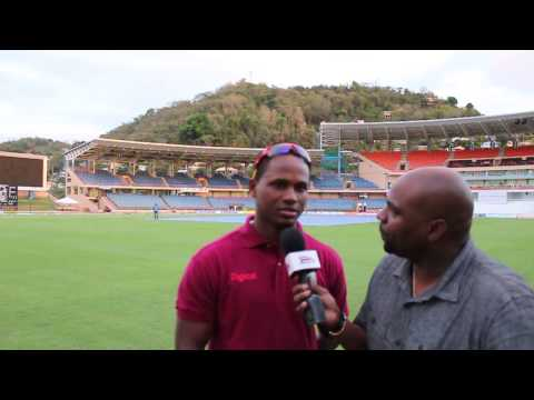 Marlon Samuels talks with his bat