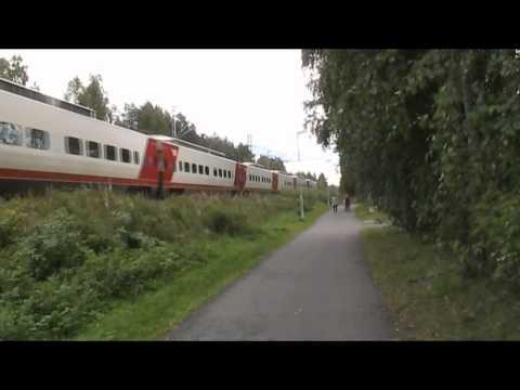 13.08.2011 passenger train H405 passes Koskela, Exceptionally Sm3 Pendolino train frame.