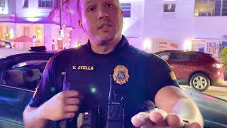 Miami cop attacks cameraman refusing to leave a public sidewalk (EPIC FAIL)