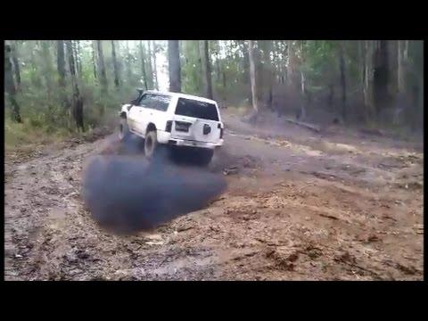 Nissan Patrol GU rd28 2 8 turbo diesel and with turbo diesel hilux playing  in the mud