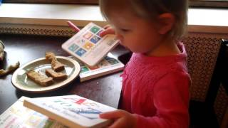 Imogen reading Sandra Boynton books