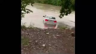 A young man throws a BMW into the river as a gift