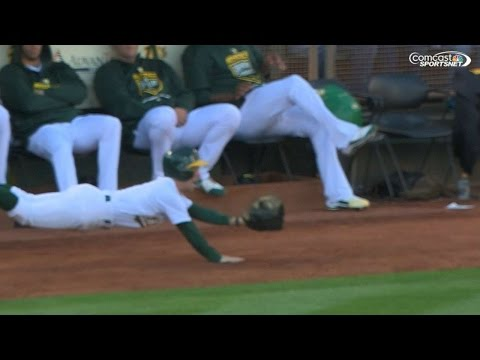 Ballboy makes heroic diving stop on foul ball