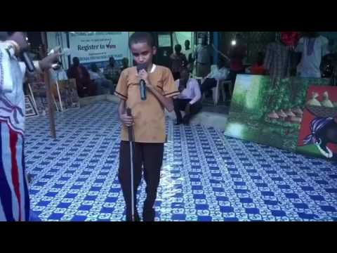 A blind Liberian boy sings to Flavour's song