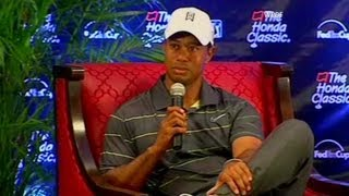 Tiger Woods blankly stares at reporter