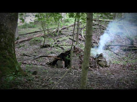 FIREPLACE INSIDE SURVIVAL SHELTER OVERNIGHTER