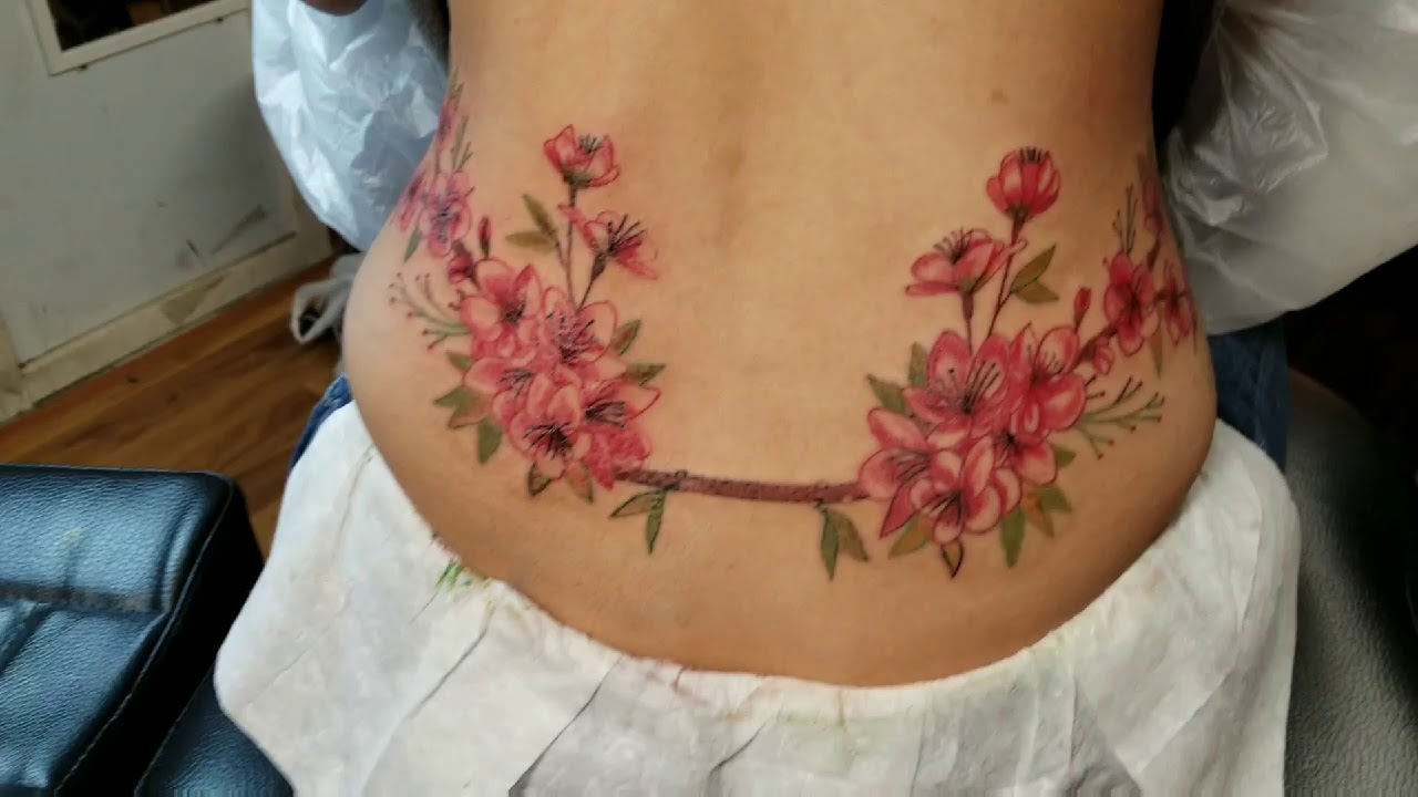 Flowers Bouquet On Female Lower Back Tattoo By Boris Kuryakin April