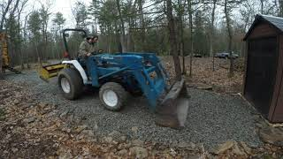 Spreading out gravel and moving brush