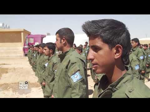 Syrians try to salvage life from the wreckage of Raqqa