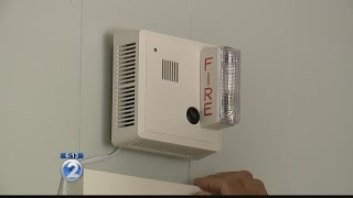 Firefighters install smoke alarms for deaf, hearing-impaired