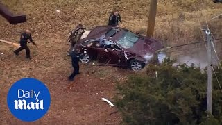 Car FLIPS into telephone pole during high speed police chase