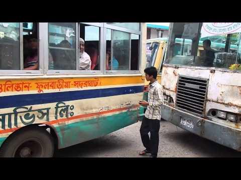 Dhaka city bus helper calling for passenger