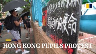 Hong Kong students protest over online claims about school expulsion warning