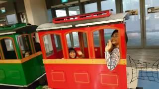 Riding mini train with kids at kallang wave mall