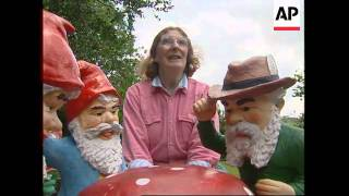 UK: DEVON: WOMAN WHO COLLECTS GARDEN GNOMES