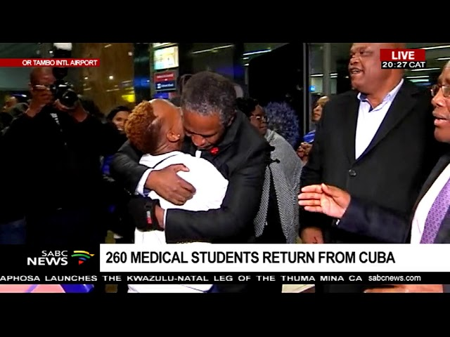 Two hundred and sixty medical students return home from Cuba after completing their studies.