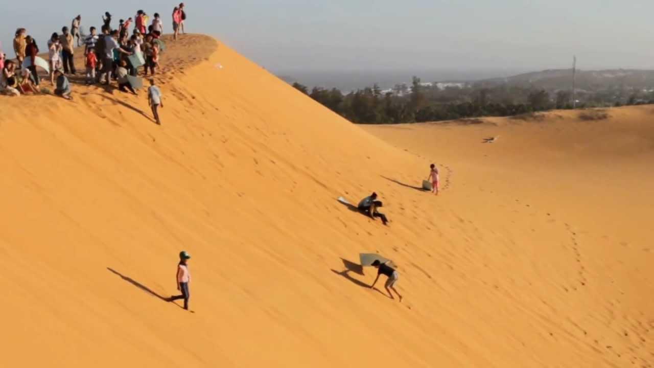 Dune Surfing At Mui Ne Red Sand Dunes Vietnam
