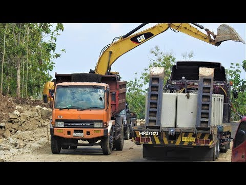 Excavator Self Loader Truck Dozer Compactor And Ready Mix At Road Construction Work