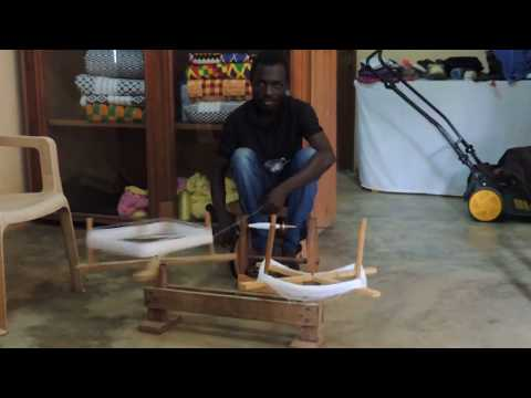 Hand Spinning Thread Before Weaving into Kente Cloth in Ghana, West Africa