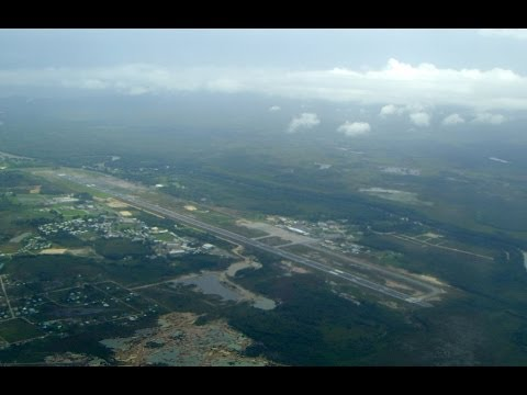landing-in-belize,-dealta-air-lines,-belize-city,-belize,-north-america