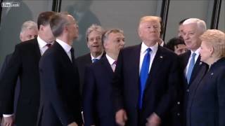 TRUMP PUSHES HIS WAY TO THE FRONT AT THE NATO SUMMIT