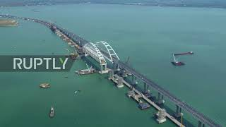 Drone footage captures opening day of Kerch Strait Bridge Subscribe to our channel! rupt.ly/subscribe Drone footage released on Tuesday, shows the Kerch Strait Bridge, set to connect the Crimean Peninsula with the ...