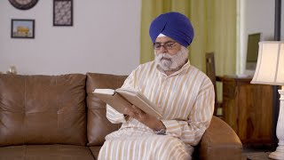 Close-up shot of old Sikh man enjoying Sunday afternoon reading a spiritual book - Spending time at leisure