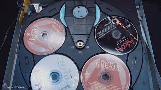 Look inside a 5-disc CD player [4K]