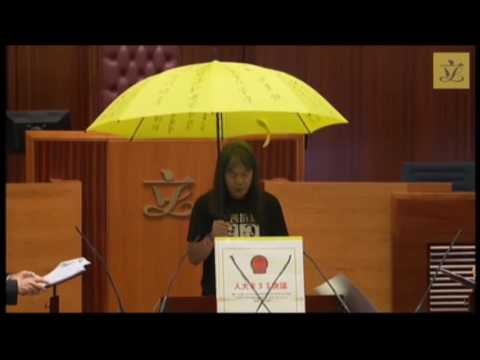 Leung Kwok-hung Holds Yellow Umbrella While Taking Oath of Office