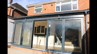 Supalite Tiled Lean To Conservatory with Anthracite Grey Bi-fold doors