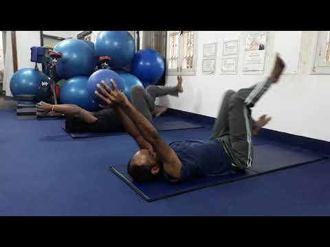 Cycling ab and low back workouts using a medicine ball