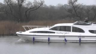 good dazzling light boat on River yare   4Apr2016 Strumpshaw Fen Norfolk UK 1028a