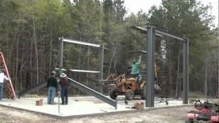 Steel building assembly using Case 580C backhoe