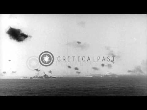 Antiaircraft guns fire as Japanese planes attack US Navy ships in the Pacific Oce...HD Stock Footage