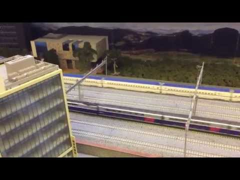 My latest & best N gauge layout 4-8 roads wide, 70ft/22meters long, sound, trams, high rise etc..