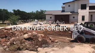 Texas Style dry river creek bed by JXC Landscaping