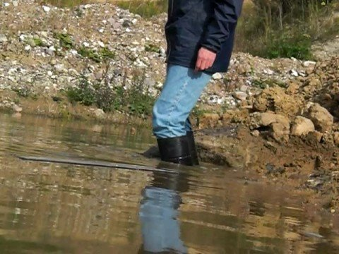 Black Wellies In Water And Mud In Gravel Pit Youtube