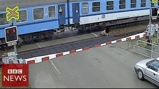 CCTV: Czech man nearly hit by train - BBC News