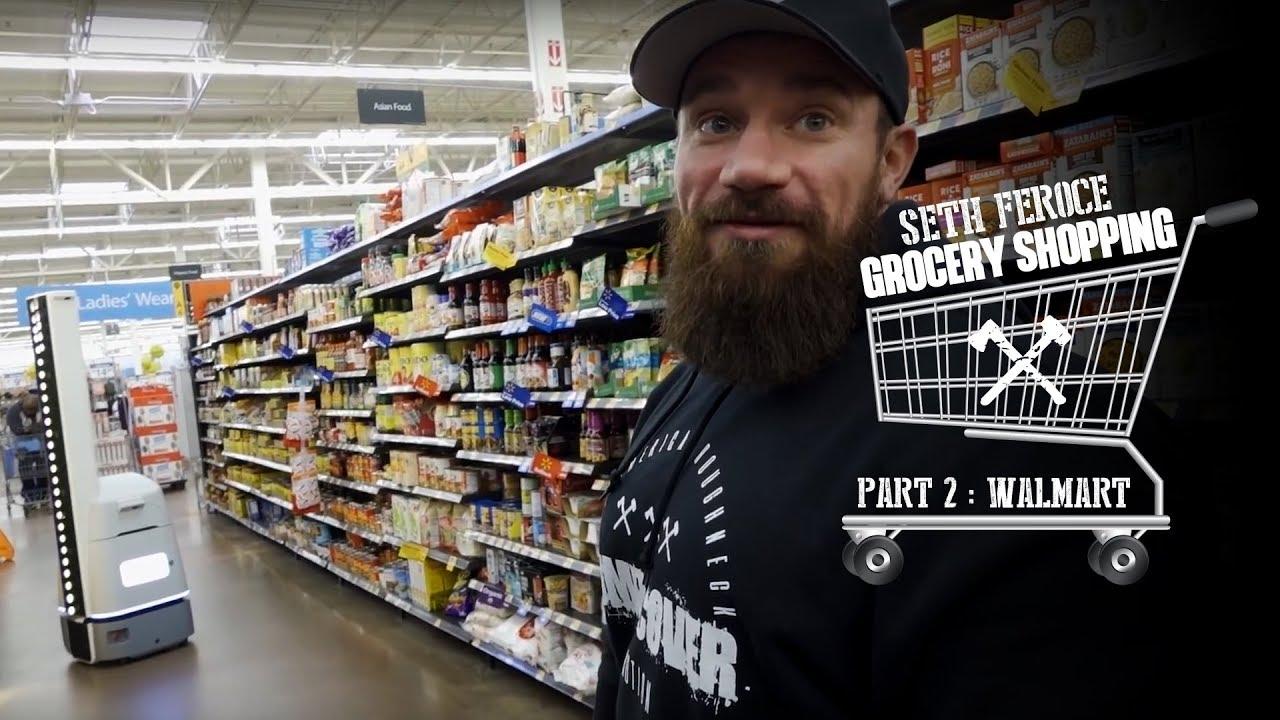 Men grocery shopping at walmart