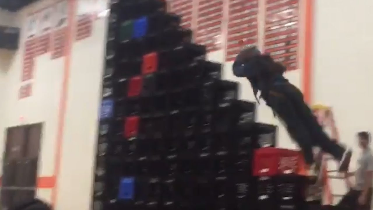 girl is pulled head first into a stack of crates what s trending