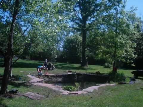 Laying flagstone edging around our natural pond youtube for Putting in a pond