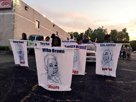 LIVE: Protesters take to the streets of Ferguson one year af