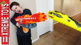 Nerf Guns Vs. Wild Boa Constrictor! Crazy Giant Snake Toy Tries to Attack Boys and Jaws!