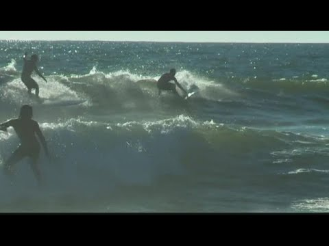 Surfers Taking Advantage Of The Waves At Virginia Beach