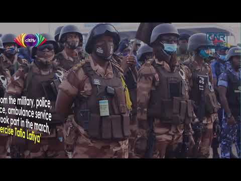 Security agencies hold peace march ahead of December polls
