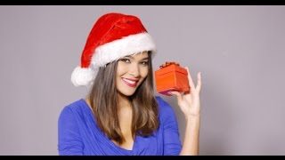 Gorgeous Woman In Santa Hat Holding Gift | Stock Footage - Videohive