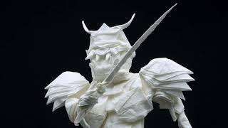 The folding process of origami Samurai Warrior